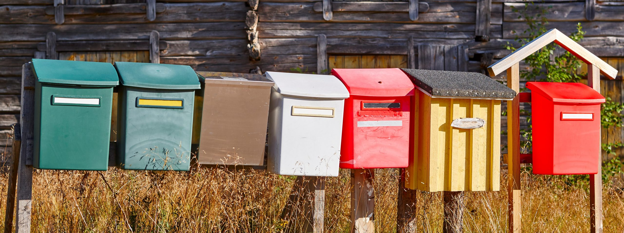 Traditional colorful vintage mailboxes in the countryside. Horizontal